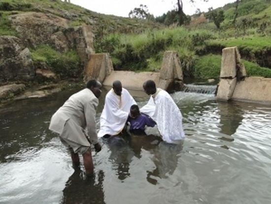 Catechumen being baptized in a river near St. Barnabas Orthodox Mission Orphanage and School