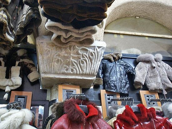 Byzantine capitals with sculpted crosses and contemporary fur coats