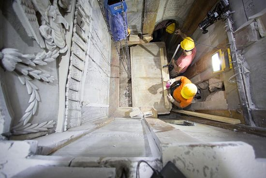 Workers begin removing the worn marble that has encased the original burial shelf for centuries, exposing a layer of fill material below. PHOTOGRAPH BY DUSAN VRANIC, AP FOR NATIONAL GEOGRAPHIC