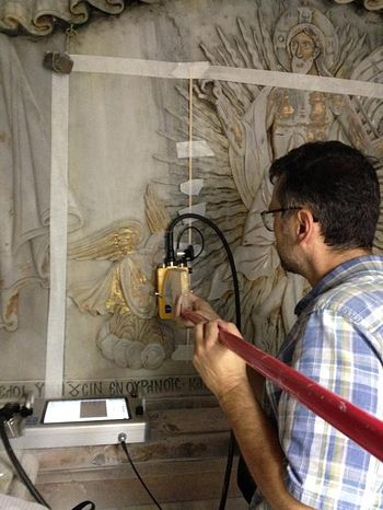 An engineer uses ground-penetrating radar to detect the walls of the original tomb behind its marble facade. PHOTOGRAPH COURTESY JERUSALEM PATRIARCHATE, NATIONAL TECHNICAL UNIVERSITY OF ATHENS
