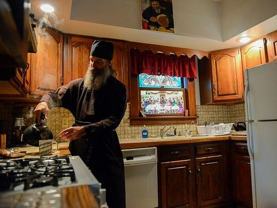 Orthodox monk Roman and his friend Terry Hansen chant during the Vespers prayer service at the St. James Orthodox Church for the Vespers prayer service Thursday, Oct. 13, 2016 in Williamston. Throughout the day Roman leads prayer services both at the church and at the monastery. (Photo: Dave Wasinger/Lansing State Journal)