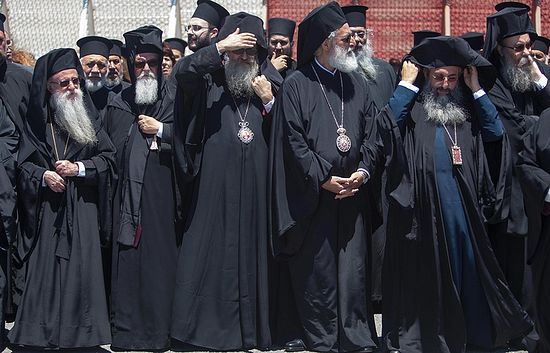 Senior Orthodox clergy at the airport of Chania in the Greek island of Crete © Holy and Great Council via AP