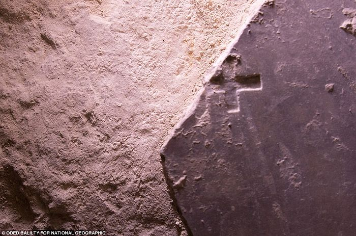 The tomb where Jesus Christ's body is said to have been rested was unveiled last month for the first time in centuries. As researchers continued their work over the course of 60 hours, another marble slab with a cross carved into its surface was exposed (pictured). Inscribed with a Christian cross, this broken marble slab may date to the Crusader era