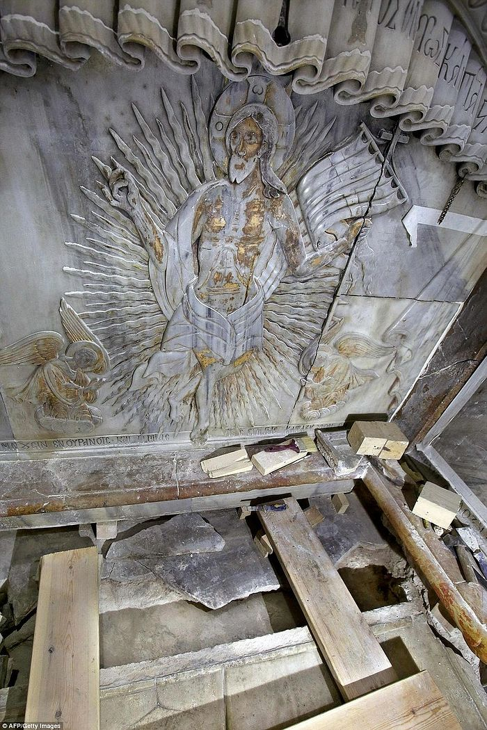 An ornate marble carving of Jesus Christ decorates the tomb where his body is believed to have been laid