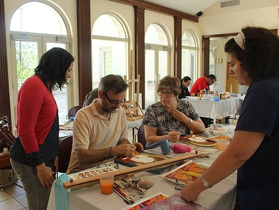 Iconographer Theodoros Papadopoulos works with students in his iconography class at St. Sophia Greek Orthodox Cathedral in Washington, D.C., in June 2016. From left to right are Lara Neri of Dallas; Paula Magoulas of Washington, D.C.; and Helen Rainey of Washington, D.C. RNS photo by Adelle M. Banks