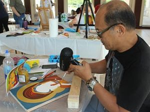 "Emmanuel ""Chito"" Santos works on an icon during a class at St. Sophia Greek Orthodox Cathedral in Washington, D.C., in June 2016. RNS photo by Adelle M. Banks"