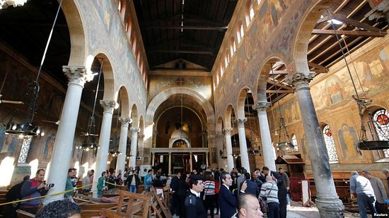 Egyptian security officials and investigators inspect the scene following a bombing inside Cairo's Coptic cathedral complex in Egypt, Dec. 11, 2016.