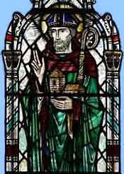 A stained glass image of St. Fergus in Glamis church
