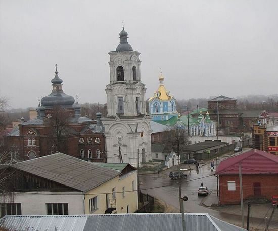 Kadom, view from Transfiguration Hill of the churches: Forefront, St. Dimitry of Rostov, next (blue), The All-Merciful Mother of God. The white building in the front was once the Holy Trinity Church. In the far background is the Church of the Burning Bush Mother of God, also partially destroyed. Photo: Daria Sofronova-Simeonoff