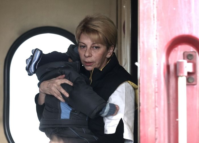 Doctor Liza would often carry Donbass children to safety herself. Photo: Moscow Times.