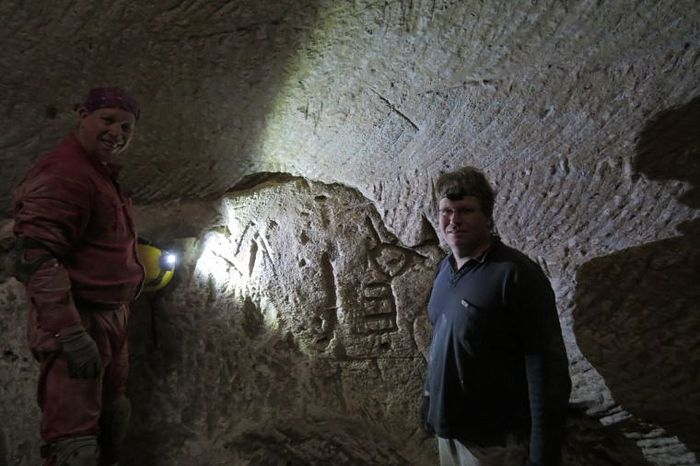 Hikers Ido Meroz and Mickey Barkal discover rare engravings of a Cross and a Menorah in an ancient water cistern in the Judean Shephelah / Sefi Givoni