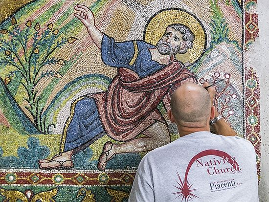 A restorer works on a wall of mosaic tiles in the Church of the Nativity in Bethlehem. Photo courtesy of Piacenti SpA