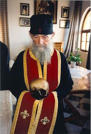 Elder Ephraim with the skull of Elder Joseph the Hesychast