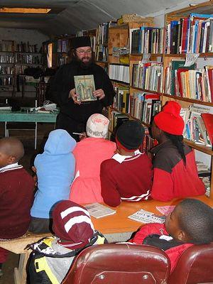 Отец Силуан проводит урок в сиротском приюте и образовательном центре святого Варнавы