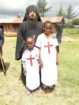 Отец Силуан со своими двумя новыми крестниками
