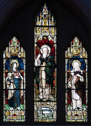 A stained glass depicting St. Fanchia with two other saints - Molaise and Dymphna