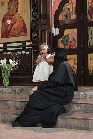 Abbess Mother Ines with one of the orphans. Photo: www.facebook.com/hogar.ayau