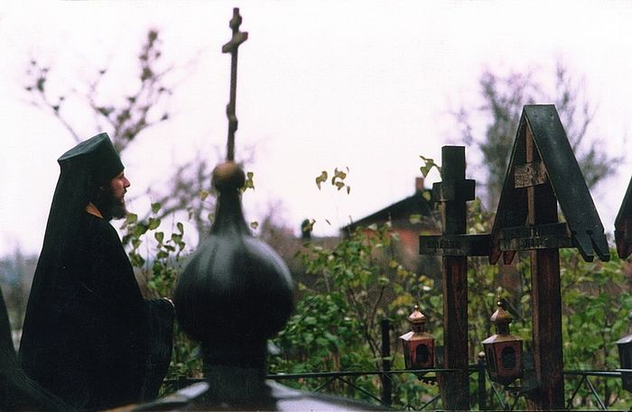 Hieromonk Vasily before the graves of the Optina elders