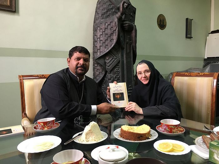 Pascha and kulich at Sretensky Monastery, with a copy of his translation of the Orthodox Prayer Book into the Urdu language.