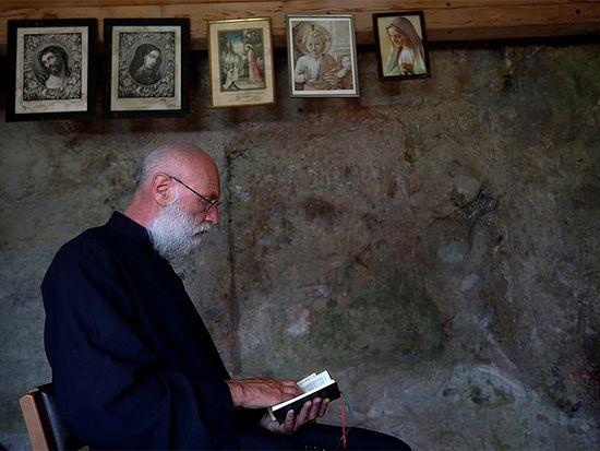 Hermit Stan Vanuytrecht of Belgium prays in his private chapel of the hermitage in Saalfelden, Austria, on May 22, 2017. Photo courtesy of Reuters/Leonhard Foeger