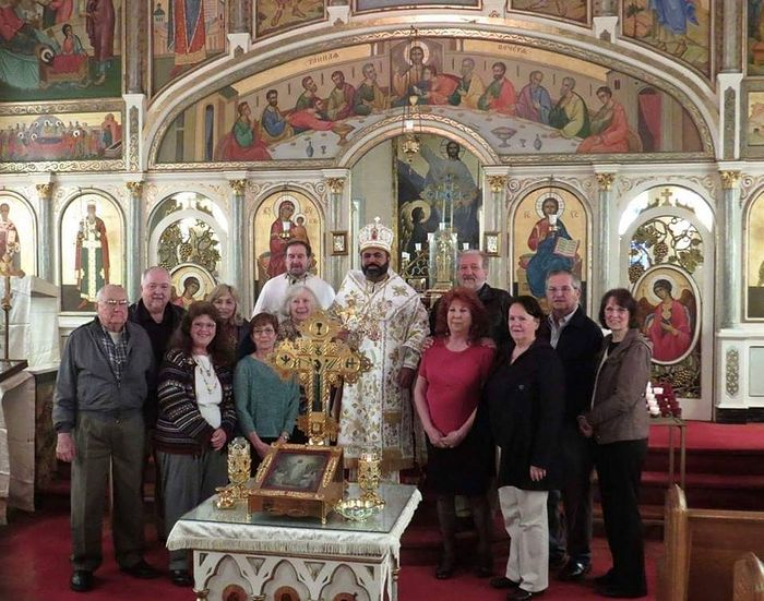 """Archbishop"" Melchisedek with ""Fr."" Michael Pasonick and parishioners. Photo: Ramzi R Mussalam FB"
