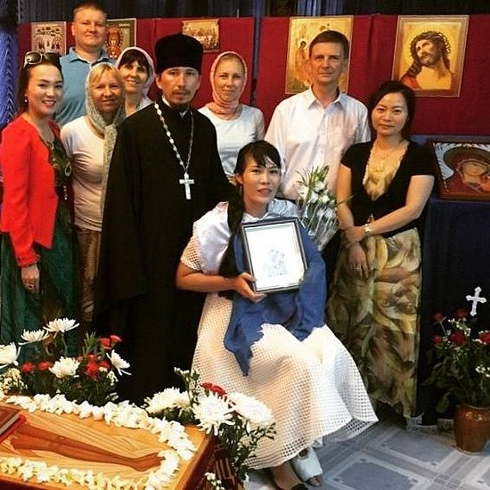 The newly-baptized Anna is seated in the picture. Photo: facebook.com