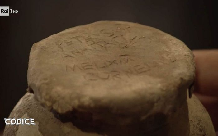 The name of St Peter is inscribed on the lid of the clay pot. Photo: CODICE/RAI UNO