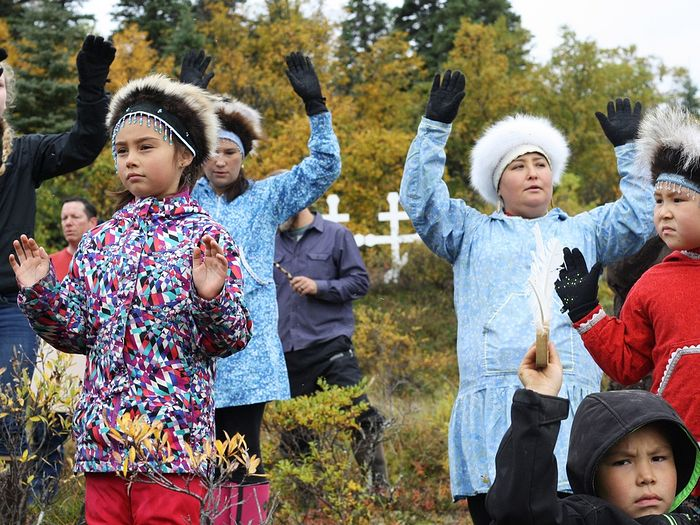 The village of Igiugig performed a traditional Yupik blessing dance following the reburial of 24 ancestors.