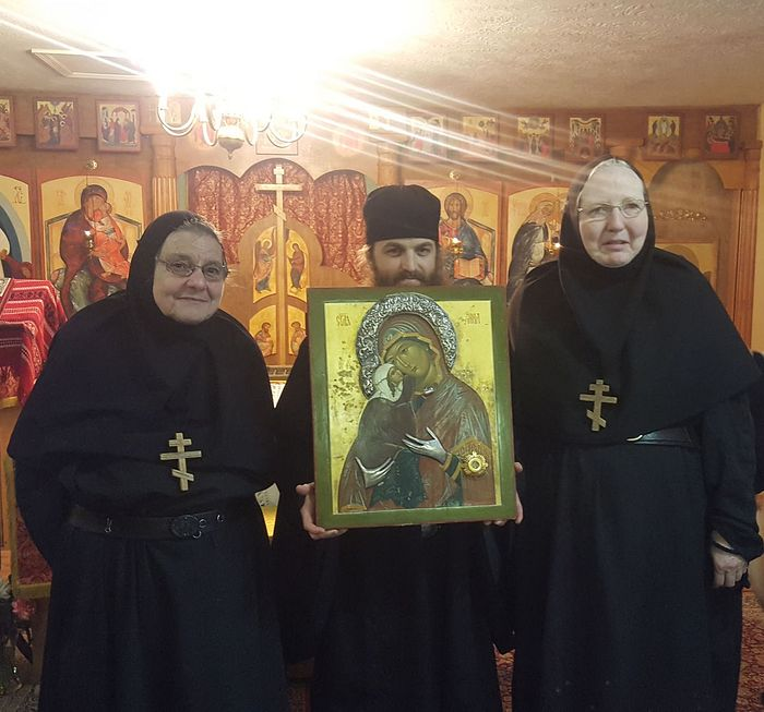 Photo: Abbess Mother Thecla and Mother Helena, monastics from Sts. Mary and Martha Monastery in Wagener and Fr. Daniel attended the icon visit.
