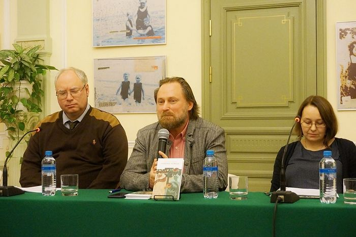 A panel discusses the publication of the Russian translation of The Superstition of Divorce. Adam Strock is seated on the left.