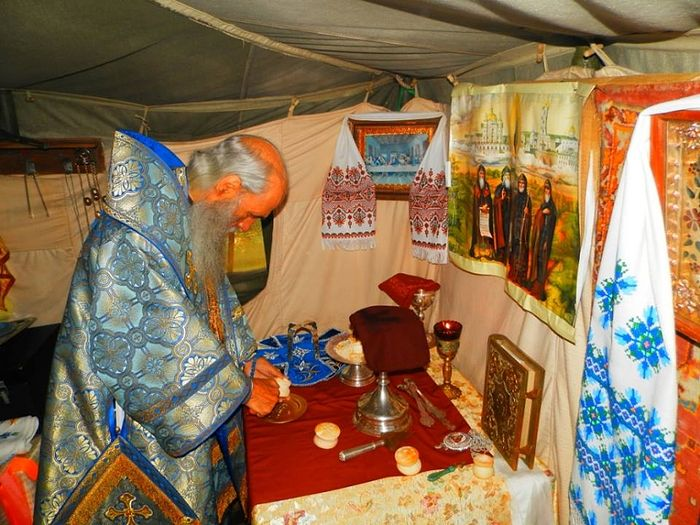 The prothesis, or proskomedia, celebrated in a tent church of the Kuty village of the Shumsk district.