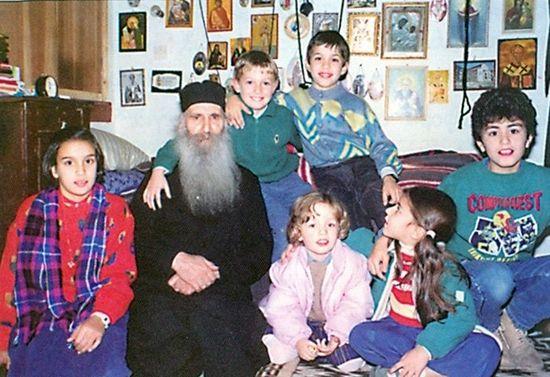 Отец Иаков в своей келлии среди детишек его родственников и духовных чад