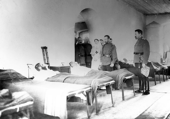 His Majesty Tsar Nicholas II and Grand Duchess Olga visiting the wounded.