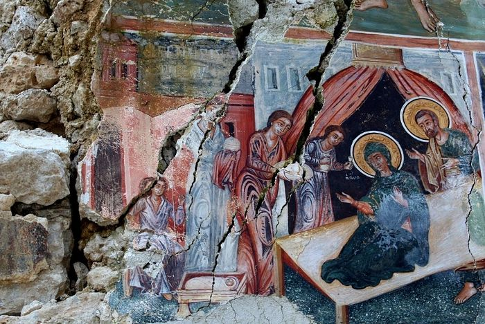 A damaged fresco is pictured in The Orthodox Church of Saint Athanasios in Leshnica, Saranda, Albania January 25, 2018. Picture taken January 25, 2018. REUTERS/Florion Goga