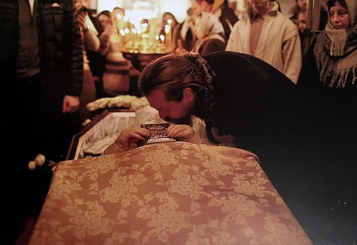 The then Archimandrite Tihon (Shevkunov) at the coffin of Fr. Alexei, who baptized him.