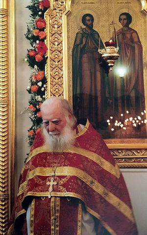 Fr. Alexei Zotov by the patronal icon of the Holy Martyrs Florus and Laurus